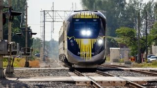 How will Brightline train get from Brevard County to Orange County?