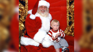 Not a fan: Hilarious Santa photo shows baby pleading for 'help