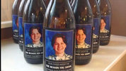 An Ohio couple gave teachers  wine for Christmas with homemade labels featuring thier son's face, saying they needed something a little stonger than a mug for coffee.