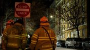 Firefighters put out a major house fire on Prospect avenue on December 29, 2017 in the Bronx borough of New York City. Over 170 firefighters respond to the evening fire in which at least 12 persons were killed with others injured.