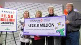 John Robinson, right; his wife, Lisa, second from the left; and their daughter, Tiffany, left, get a ceremonial check from the Tennessee Lottery on Friday, Jan. 15. 2016. Tennessee Lottery