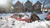FILE PHOTO: A man digs his car out of snow in Chicago, Illinois. Scott Olson/Getty Images