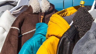Florida group hangs coats on fences, poles to help residents stay warm