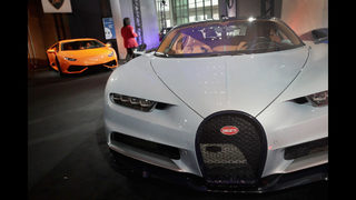 A Bugatti R And Lamborghini Are Displayed Alonside Other Exotic Sports Cars Outside The Press Center At North American International Auto Show Naias