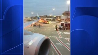 166 passengers forced off plane at Boston airport after collision with de-icing truck
