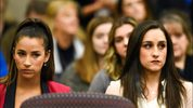 Former Olympians Aly Raisman, left, and Jordyn Wieber sit in Circuit Judge Rosemarie Aquilina's courtroom during sentencing for former sports doctor Larry Nassar, who pled guilty to multiple counts of sexual assault, Jan. 19, 2018, in Lansing, Mich.