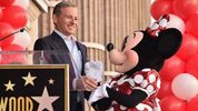 Disney's Chairman and CEO Bob Igor stands next to Minnie Mouse during a star ceremony in celebration of the 90th anniversary of Disney's Minnie Mouse at the Hollywood Walk of Fame on January 22, 2018 in Hollywood, California.