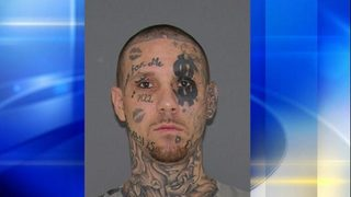 Man with tattooed face wanted for climbing in unlocked window, assaulting woman