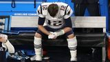 Quarterback Tom Brady, #12 of the New England Patriots, sits on the bench after having the ball stripped by Brandon Graham #55 of the Philadelphia Eagles late in the fourth quarter in Super Bowl LII at U.S. Bank Stadium on February 4, 2018.