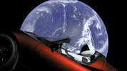 This image from video provided by SpaceX shows the company's spacesuit in Elon Musk's red Tesla sports car which was launched into space during the first test flight of the Falcon Heavy rocket on Tuesday, Feb. 6, 2018.)