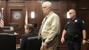 Defendant Donald Smith enters the courtroom for the start of the second day of his trial for the rape and murder of 8-year-old Cherish Perrywinkle, Tuesday, Feb. 13, 2018 in Jacksonville, Fla. (Bob Self/The Florida Times-Union via AP)