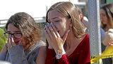 Students released from a lockdown are overcome with emotion following following a shooting at Marjory Stoneman Douglas High School in Parkland, Fla., Wednesday, Feb. 14, 2018. (John McCall/South Florida Sun-Sentinel via AP)