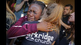 Marla Eveillard, 14, cries as she hugs friends before the start of a vigil at the Parkland Baptist Church, for the victims of the Marjory Stoneman Douglas High School shooting, which happened yesterday, in Parkland, Fla., Thursday, Feb. 15, 2018.