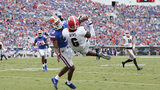 JACKSONVILLE, FL - OCTOBER 28: Javon Wims #6 of the Georgia Bulldogs catches a 17-yard touchdown pass over Marco Wilson #3 of the Florida Gators in the first quarter of a game at EverBank Field on October 28, 2017 in Jacksonville, Florida.