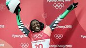 Simidele Adeagbo of Nigeria reacts as she finishes a run during the Women's Skeleton on day eight of the PyeongChang 2018 Winter Olympic Games at Olympic Sliding Centre on February 17, 2018 in Pyeongchang-gun, South Korea.