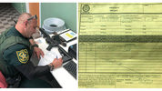 A Broward County sheriff's deputy fills out paperwork after Ben Dickmann, 40, of Fort Lauderdale, voluntarily surrendered his AR-57 semiautomatic rifle. (Photos courtesy of the Broward County Sheriff's Office)