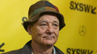 SXSW 2018: Bill Murray recites poem on street while wearing overalls, bucket hat