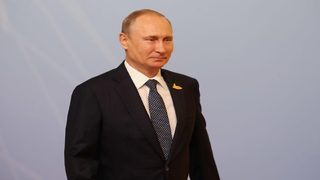 Exit poll: Putin wins re-election in landslide