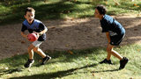 LAUNCESTON, AUSTRALIA - MARCH 10: Children play football prior to the JLT Community Series AFL match between the Hawthorn Hawks and the Carlton Blues at the University of Tasmania Oval on March 10, 2018 in Launceston, Australia.