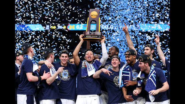ba4a09a2912d Jalen Brunson  1 of the Villanova Wildcats raises the trophy and celebrates  with his teammates after defeating Michigan during the 2018 NCAA Men s  Final ...