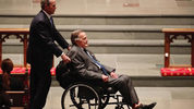 Former President George H.W. Bush, assisted by his son, former President George W. Bush, enter the church during the funeral for former First Lady Barbara Bush on April 21, 2018 in Houston, Texas. (Photo by Brett Coomer - Pool/Getty Images)