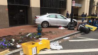 Watch: Good Samaritans lift car off trapped victims after crash