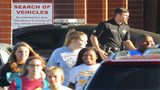 Students pass by a Laurens County Sheriff's deputy stationed at East Laurens High School on Tuesday, May 2, 2018, in Dublin. Laurens County is the first school district in Georgia to allow teachers and other school personnel to carry weapons.