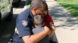 Round Rock police Chief Allen Banks hugs Ximena and her brother during a visit to their home. Ximena had given her $4 allowance to the Police Department as a kind gesture after the funeral of Round Rock police officer Charles Whites last week.