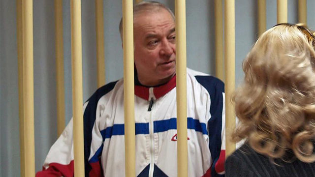 A photo dated Aug. 9, 2006 shows Sergei Skripal talking from a defendants  cage to his lawyer during a hearing at the Moscow District Military Court  in ...