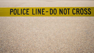 Police: Dead body found in abandoned car in Michigan