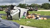 A FedEx freight truck rests on its side after it crashed on a Florida interstate Tuesday morning. The driver of the truck was killed.