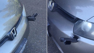 Police: Driver finds gun stuck in front of his car