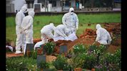 Paramedics wear protective suits on May 24, 2018, as they bury a man who died of the Nipah virus in Kozhikode, in the southern Indian state of Kerala. More than 10 people have died of Nipah since an outbreak began earlier this month.  (K.Shijith/AP)