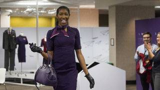 Delta debuts uniforms in 'Passport Plum