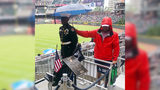 Atlanta Braves Fan Shields JROTC Member From Rain