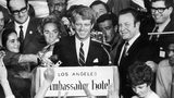 Sen. Robert Kennedy (C) addressing crowd from stage w. wife Ethel, former football star Rosey Grier & photographer Bill Eppridge standing in background. (Julian Wasser/The LIFE Picture Collection/Getty Images)