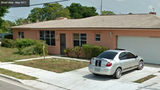 The Fort Pierce, Florida, home where Gregory Vaughn Hill Jr. was slain Jan. 14, 2014, by a St. Lucie County sheriff's deputy is pictured in a May 2011 Google Street View image. Hill, 30, was shot three times through the garage door after deputies