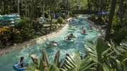 Guests float along Castaway Creek, the lazy river at Disney's Typhoon Lagoon Water Park at Walt Disney World Resort in Lake Buena Vista, Fla.