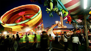 Woman falls out of carnival ride, sprains wrist