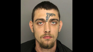 Man with gun tattoo on forehead charged with illegal gun possession