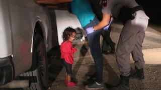 Behind the viral photo of toddler crying at the US border