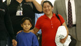 Migrant mother, 7-year-old son reunited after being separated at border