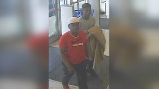 Men use blanket to attack woman inside department store, police say