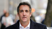 FILE - In this April 11, 2018, file photo, Michael Cohen, President Donald Trump's personal attorney, walks along a sidewalk in New York. Cohen is searching for a new legal team to represent him in an FBI investigation of his business dealings.