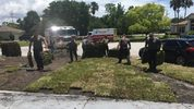 After firefighters and paramedics took a man suffering from a heart attack to the hospital, they returned to lay the sod he was unable to.