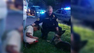 Police officer says prayer over boy before brain surgery