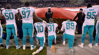 NFL, players union agree to halt new anthem policy for now, seek resolution