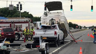 Boat breaks free, crashes onto truck towing it, officials say