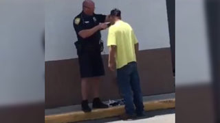 Police officer helps homeless man with shave so he can get job