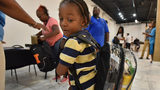 Jacques Thomas, 4, turns his head to check his school supplies inside a clear backpack during No Bare Soles Annual Shoe Distribution at Caring For Others headquarters on Saturday, July 15, 2017.